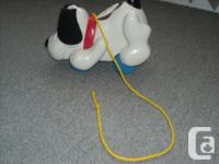 Like new, toddler pull toy that barks, makes funny