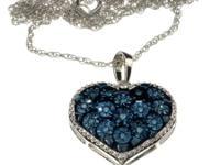 Stunning blue diamond heart shaped pendant in 14k gold