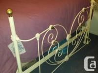 This bed is a beautiful antique brass and iron 4 poster