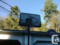 Portable and height adjustable basketball hoop w/net.