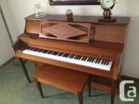 This heintzman piano is home sized with a full noise