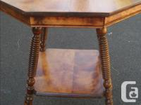 This most unusual Bird's Eye Maple table is in