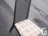 Here is a high cane back chair with a plaid seat good