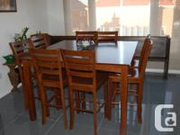 Square dining table with 8 chairs, made of solid wood,