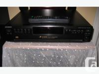 The Sony CDP-CE245 5-disc changer features a carousel