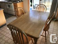 Solid maple heavy table and match four chairs, ideal