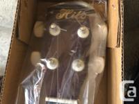 For sale today is my Hilo deluxe soprano Uke Dark brown