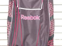 This is a Reebok stand-up, rolled hockey bag, model