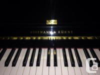 Beautiful condition upright piano. Amazing sound and