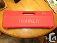 """Hohner """"Fire"""" melodica 32-keys, piano style, red Comes"""
