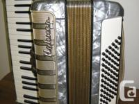Hohnor accordian Gray with gold accents, from the