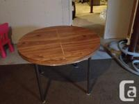 Round table converts to an extended oval. When round,
