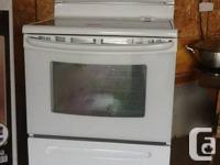 "Kenmore self cleaning ""ceram leading"" four burner oven."