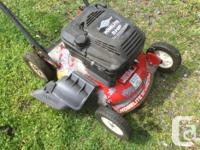 5 HP HomeLite mower with Briggs & Stratton engine. 20""