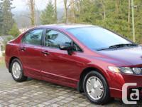 Make Honda Model Civic Year 2009 Colour REd kms 55552