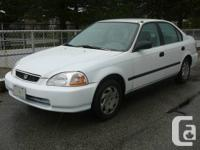 A clean White Honda Civic EX 1997 is for sale. It is