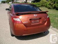 Make Honda Model Civic Si Year 2009 Colour Orange kms
