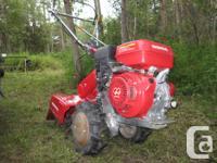"Honda FR800 tiller 20 tilling width, 12"" tine diameter,"