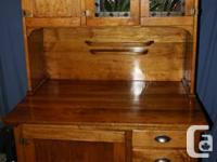 This two-piece, vintage hoosier style hutch is in