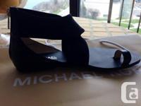 Michael Kors gladiator sandal size 6.5. *** Never worn