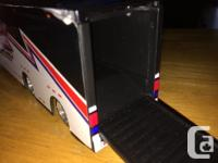This is a car transporter for Hotwheels sized toy cars.