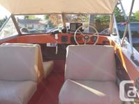Solid hull and transom, solid floor, seats four with