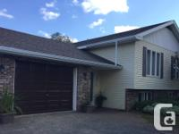 Four bedroom side split with attached garage, on large,