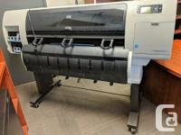 This plotter is in working condition and comes with a