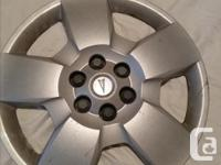 Hubcaps used on Pontiac Montana tires. Reduced price.