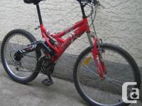 Huffy - Tundra with full suspension and 24 inch tires