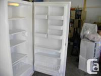 White Frigidaire upright freezer, not frost free, runs