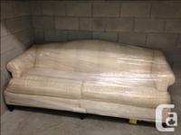 Older humpback style couch, in great condition. Wood