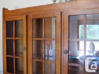 Solid wood hutch with glass front doors. In fantastic
