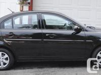 Make Hyundai Model Accent Year 2009 Colour Black kms