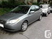 I am selling a 2010 Elantra, dark Grey with Grey