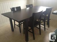 We are selling an IKEA Bjursta extendable kitchen table