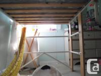 White metal and wood loft bed is half the height of