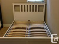 In excellent condition, includes wood slats. White bed