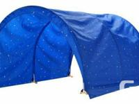 This is a tent/canopy for the Kura bed in blue, which
