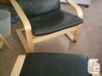 Black leather Ikea Poang chair with matching black