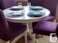 White round table for four persons which can become an