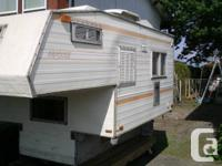 "Older camper, 7'10"" length, fits import truck. Roof"