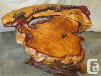 Incredible carved Burl table has carved whales and