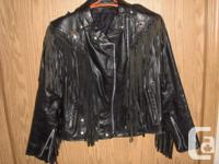 Beautiful 'vintage' fringed leather jacket, made in
