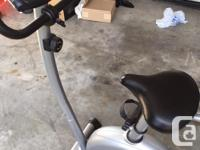 Great exercise bike that is in new condition, hardly