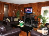 With recovered hardwood floor covering throughout and