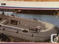 "SeaHawk Inflatable Sport Boat. 117""x50"". Hold up to"
