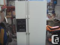 side-by-side refrigerator with water and ice