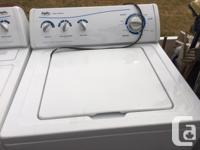 Top load washer with huge barrel electric dryer.
