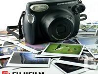 The Fujifilm instax 210 Instant Film Camera is a